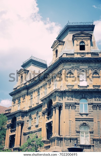 Budapest, Hungary - old residential architecture. Vintage townhouse. Desaturated retro colors style.