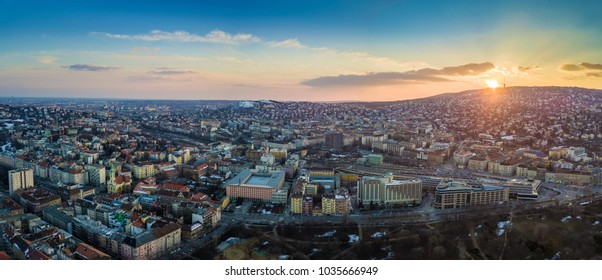 Budapest, Hungary - Panoramic aerial skyline view of the west Buda side of Budapest with railway station and Buda Hills at background at sunset