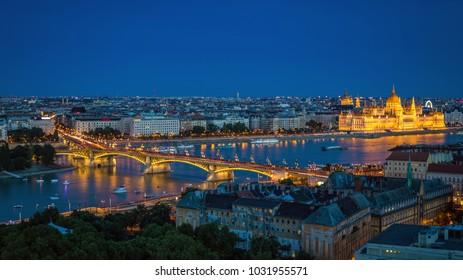 Budapest, Hungary - Panoramic skyline view of Budapest at blue hour with the illuminated Parliament of Hungary, Margaret Bridge and Margaret Island