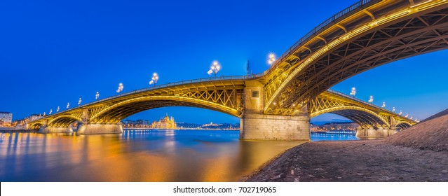 Budapest, Hungary - Panoramic skyline view of the beautiful Margaret Bridge at blue hour with the Parliament of Hungary and other famous landmarks