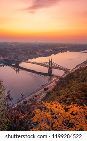 Budapest, Hungary - Panoramic view of the Gellert Hill at sunrise with skyline of Budapest, Libery Bridge and River Danube at autumn morning