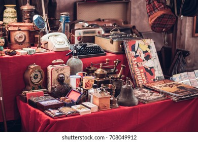 BUDAPEST, HUNGARY - SEP 2, 2017: Flea market - antique watches, magazines, phones and other retro products are displayed on a table at the regular Weekend Market of Gozsdu Courtyard, Budapest.