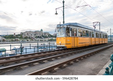 BUDAPEST HUNGARY -SEP 20: Famous yellow tramways along Danube on September 20, 2016 in Budapest. One of the most iconic images of the city