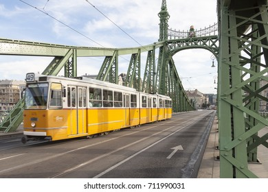 BUDAPEST HUNGARY -SEP 20: Famous yellow tramways in the Liberty Bridge on September 20, 2016 in Budapest. One of the most iconic images of the city