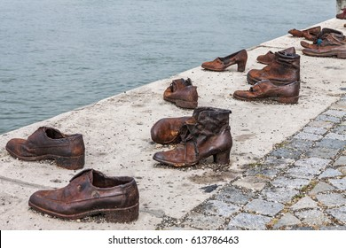 BUDAPEST HUNGARY -SEP 22:  Shoes on the Danube Bank on September 22, 2016 in Budapest. Iron Shoes Memorial to Jewish People who were killed during World War 2, on the Pest side at Budapest, Hungary.