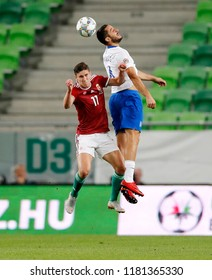 BUDAPEST, HUNGARY - SEPTEMBER 11, 2018: (r-l) Kostas Manolas wins the ball in the air from Roland Sallai during Hungary v Greece UEFA NL match at Groupama Arena.