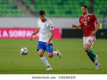 BUDAPEST, HUNGARY - SEPTEMBER 11, 2018: (l-r) Sokratis Papastathopoulos controls the ball next to Marton Eppel during Hungary v Greece UEFA NL match at Groupama Arena.