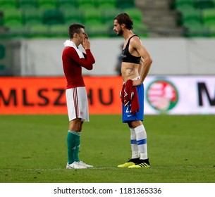 BUDAPEST, HUNGARY - SEPTEMBER 11, 2018: (l-r) Adam Nagy and Marios Oikonomou talk to each other during Hungary v Greece UEFA NL match at Groupama Arena.