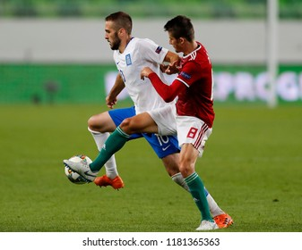 BUDAPEST, HUNGARY - SEPTEMBER 11, 2018: (l-r) Kostas Fortounis competes for the ball with Adam Nagy during Hungary v Greece UEFA NL match at Groupama Arena.