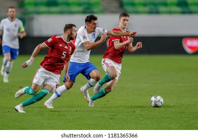 BUDAPEST, HUNGARY - SEPTEMBER 11, 2018: Lazaros Christodoulopoulos (r2) tries to break out between Attila Fiola #5 and Roland Sallai (r) during Hungary v Greece UEFA NL match at Groupama Arena.