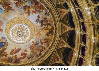 BUDAPEST, HUNGARY, - September 12 2016 : Interior of the Hungarian Royal Opera House.Detail of auditorium with Karoly Lotzâ??s monumental cupola fresco