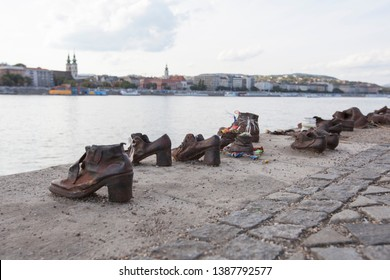BUDAPEST, HUNGARY - SEPTEMBER 18, 2017: The Shoes on the Danube Bank is a memorial in Budapest, Hungary. Sculptor Gyula Pauer art honour the Jews who were killed by fascist Arrow Cross militiamen.