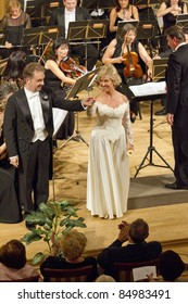 BUDAPEST, HUNGARY - SEPTEMBER 18: Tamas Clementis (l) and Ingrid Kertesi, singers of the Hungarian State Opera on the stage of ELTE University on September 18, 2011 in Budapest, Hungary.