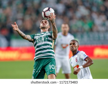 BUDAPEST, HUNGARY - SEPTEMBER 2, 2018: (l-r) Davide Lanzafame controls the ball in front of Loic Nego during Ferencvarosi TC v MOL Vidi FC match at Groupama Arena.