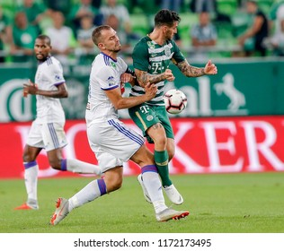 BUDAPEST, HUNGARY - SEPTEMBER 2, 2018: Roland Juhasz (l2) fights for the ball with Davide Lanzafame (r) in front of Paulo Vinicius (l) during Ferencvarosi TC v MOL Vidi FC match at Groupama Arena.