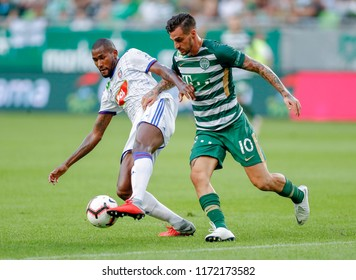BUDAPEST, HUNGARY - SEPTEMBER 2, 2018: (l-r) Paulo Vinicius competes for the ball with Davide Lanzafame during Ferencvarosi TC v MOL Vidi FC match at Groupama Arena.