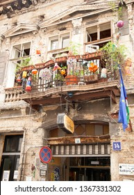 BUDAPEST, HUNGARY - SEPTEMBER 20, 2017: Szimpla Kert isa huge and eclectic pub with old mismatched items & a disused Trabant car, with music, food, market & a garden.