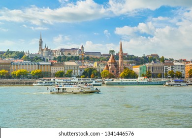 Budapest, Hungary - September 25 2018: The Szilágyi Dezso Square Reformed Church on the banks of the Danube River in Budapest Hungary with the Castle District, St Matthias Church above