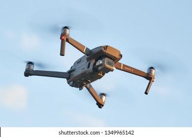 BUDAPEST, HUNGARY - SEPTEMBER 25, 2018: DJI Mavic 2 Pro drone midflight featuring a camera a major camera upgrade over the previous Mavic model. Blue sky backgorund
