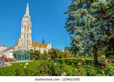 Budapest, Hungary - September 27 2017: Tourists and visitors enjoy an afternoon outside the Roman Catholic Matthias Church, part of the Buda Castle Complex in Budapest, Hungary.