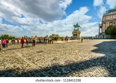 Budapest, Hungary - September 28 2017: Tourists pass by the equestrian statue of Prince Savoyai Eugen on the terrace in front of the Royal Palace at the Buda Castle Complex in Budapest Hungary