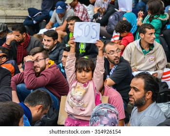 BUDAPEST, HUNGARY - SEPTEMBER 5, 2015 : Refugees at the Keleti Railway Station on 5 September 2015 in Budapest, Hungary. Refugees are arriving constantly to Hungary on the way to Germany.
