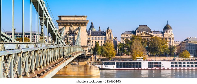 Budapest, Hungary skyline with perspective of chain bridge on Danube river and cruise ship