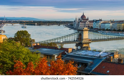 Budapest, Hungary - Sunrise over Budapest with Szechenyi Chain Bridge, Parliament and colorful autumn trees