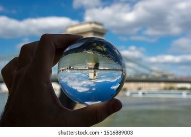 Budapest, Hungary - Szechenyi Chain Bridge which view through glass lens ball