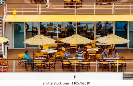 Budapest Hungary-Apr. 26, 2018: People are sunning on a deck of a river cruise ship in Budapest.