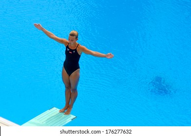 BUDAPEST, HUNGARY-AUGUST 01,2006: Professional diver woman concentrated on springboard during the European Swimming Championship in Budapest.