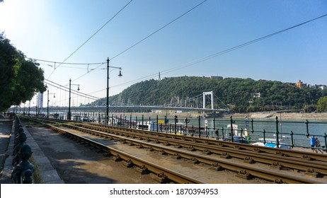 Budapest, Hungary-July 2018: Cityscape view next to the river Danube and tram trails during early morning sunny day. World city landmarks.