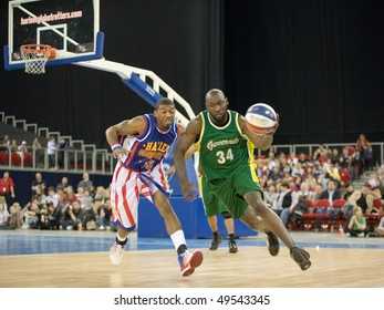 BUDAPEST - MARCH 23: The world famous Harlem Globetrotters basketball team in an exhibition match against Washington Generals at Sportarena on March 23, 2010 in Budapest, Hungary.