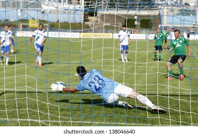 BUDAPEST - MAY 10: Federico Groppioni of MTK (L) saves a penalty during MTK vs. Paks OTP Bank League football match at Hidegkuti Stadium on May 10, 2013 in Budapest, Hungary.