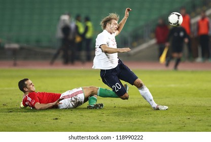 BUDAPEST - NOVEMBER 14: Hungarian Roland Juhasz (L) and Norse Alexander Toft Soderlund during Hungary vs. Norway  friendly football game at Puskas Stadium on November 14, 2012 in Budapest, Hungary.