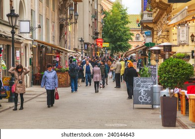 BUDAPEST - OCTOBER 22: Vaci street with tourists on October 22, 2014 in Budapest, Hungary. It's one of the main pedestrian thoroughfares and perhaps the most famous street of central Budapest