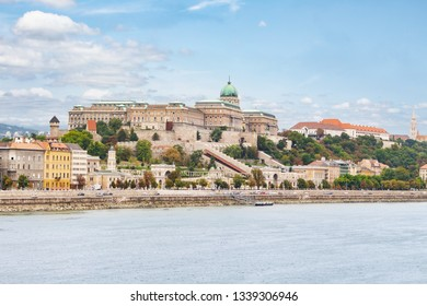 Budapest - a panorama of the city with a visible castle and the Danube riverbank.