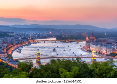 Budapest Panorama with parliament and bridges during evening twilight sunset. View from Citadel.