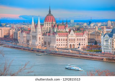 Budapest Parliament building at dusk on the Danube river - Budapest, Hungary
