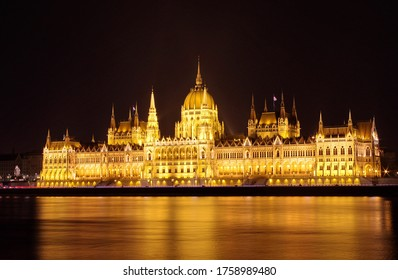 Budapest parliament building at night, long exposure. Hungarian Parliament building and Danube River in the Budapest city at night. Neo-gothic architecture, Budapest's tourist attraction