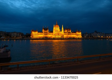Budapest Parliament building at night on the Danube river in Hungary
