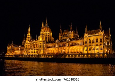 Budapest Parliament in Hungary at night on the Danube river