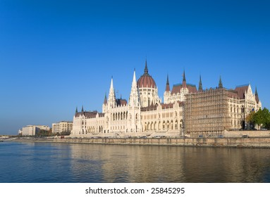 Budapest parliament over blue sky with river Danube