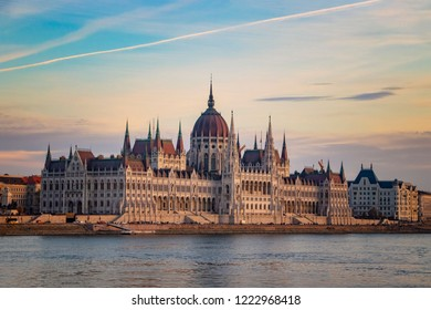 Budapest parliament at sunset. Beautiful view on historical building over the Danube river. It is situated in Hungary.