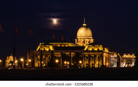 Budapest Royal Castle by night. The castle is lit with warm light. Moonlit night.