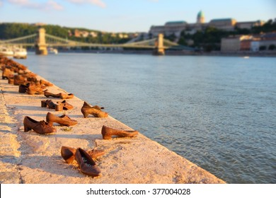 Budapest shoes - Holocaust memorial monument in Hungary. Sunset light.