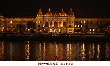 Budapest, Technical University's building at night beside river Danube