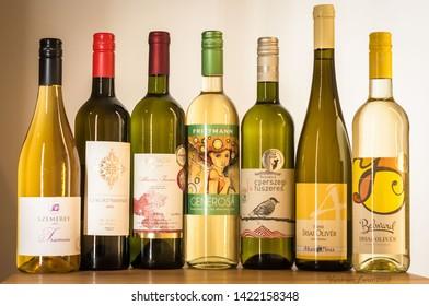 """Budapest/Hungary - 01-21-2018: Hungarian Wine sets, wine's still life DEGUSTATION SET """"Fehér Magyar Szőlőfajták"""" IrsaiOlivér, Belward, Ákos, CserszegiFűszeres, Bezerics, Generosa, Frittmann"""