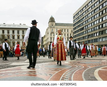BUDAPEST,HUNGARY, 09 APRIL 2016 :Spring celebration parade through the streets of downtown.Folk dancers in front of St. Stephen Basilica.
