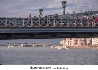 BUDAPEST/HUNGARY - 25 SEPTEMBER 2017: Static long shot of people and traffic crossing the Chain Bridge in Budapest. Taken on a September afternoon